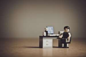 Imageof legoman at his desk looking concerned for blog by Growtraffic on how do I get my website to rank in Google