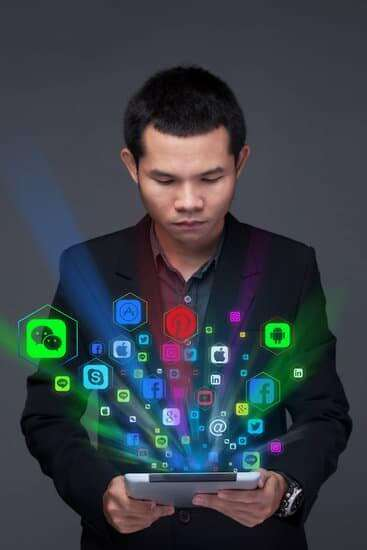 the image shows a man using lots of different social media apps