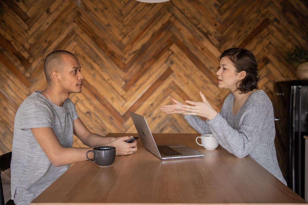 an outsourced SEO agent talking to a man