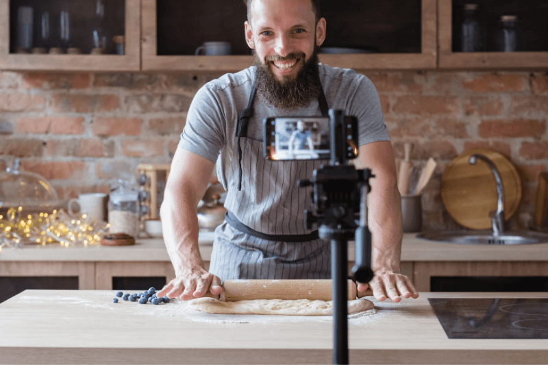Man using Facebook Live for business