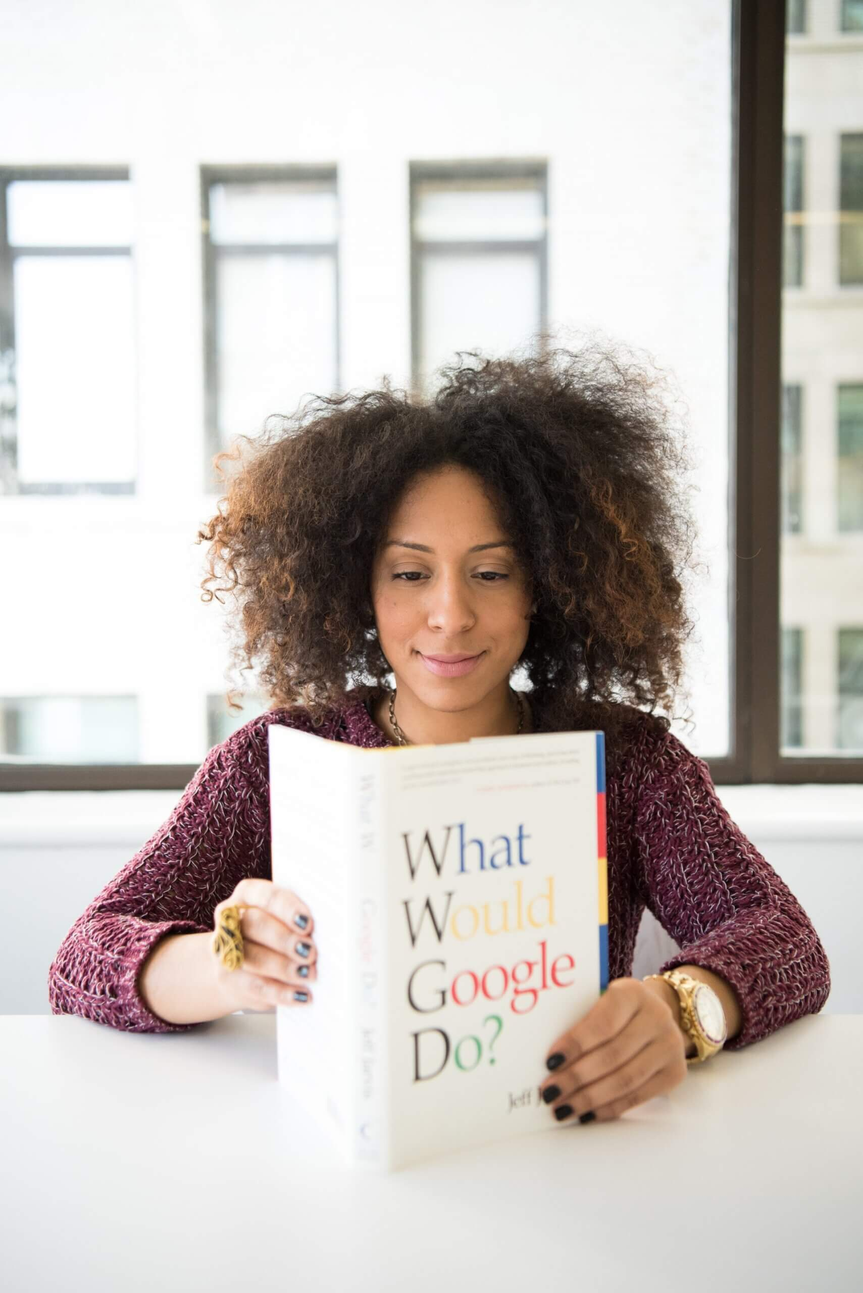 woman reading a book for blog by GrowTraffic on how to get readers to your blog