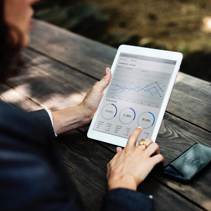 Woman holding a tablet looking at analytics