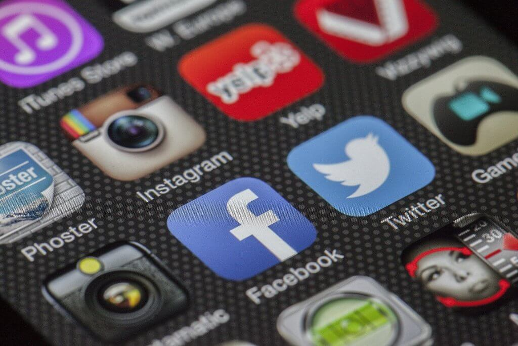 Social media apps on Iphone screen for blog How Can I Help My Social Media Marketing Agency
